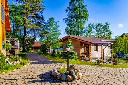 Street lighting. Cottage village. Guest House. Path of stone. Natural stone. Sunny day.