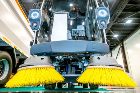 Brushes for cleaning the streets are fixed on the car. Special machinery. Machine with tassels. Cars for cleaning in the city. Automatic road cleaning brushes. Washing sidewalks.