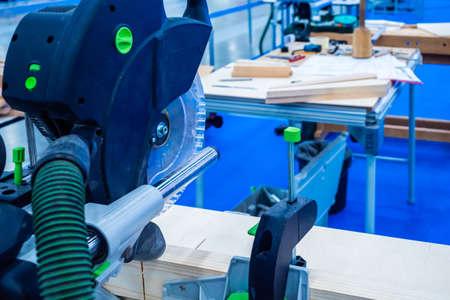 Carpentry workshop. Circular saw for wood. Carpenter services. Woodworking Machine. Making furniture to order. Furniture shop.