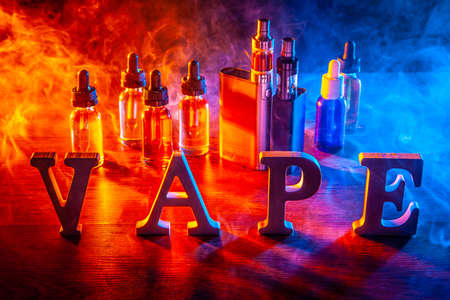 VAPE Electronic Cigarette. Liquid for VAPE. Steam from an electronic cigarette. VAPE concept 写真素材