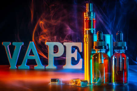the inscription VAPE Electronic Cigarette. Liquid for VAPE. Steam from an electronic cigarette. VAPE concept