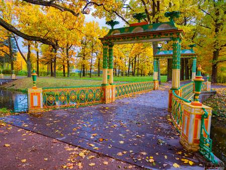 Saint Petersburg. Russia. Leningrad region. Town of Pushkin. Tsarskoe selo. Autumn in the suburbs of St. Petersburg. Small Chinese bridge. Golden autumn in Russia. Autumn Park in Tsarskoye Selo.
