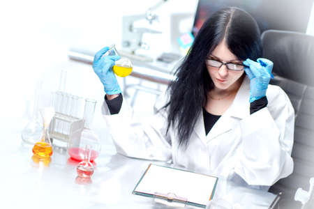 Pharmaceutical laboratory. A female bioengineer calculates the formula of a new medical drug. Clinical studies of drugs. Development of new medicines. Pharmacy. Molecular engineering.