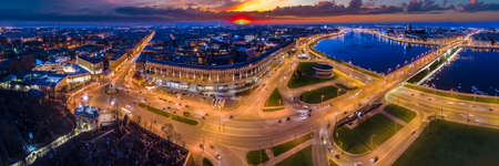 Saint-Petersburg. Russia. Evening panorama of St. Petersburg. Alexander Nevsky square at night. Night illuminated city streets. St. Petersburg traffic. The bridges of the Neva river. Russian city. Stock Photo