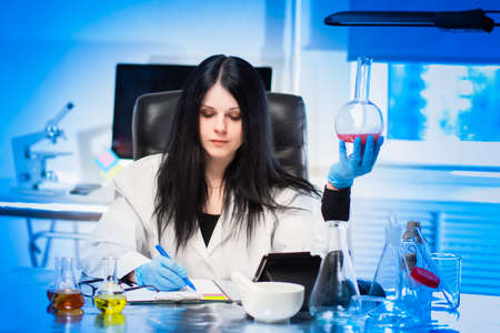 Prescription department of pharmacy. A female pharmacist technologist calculates the formula of the drug. Manufacture of prescription drugs. Pharmacy laboratory. Pharma production of medicines.