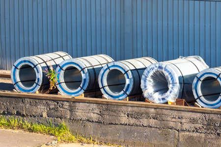 Sale of metal sheet. Production of metal sheet. Sale of metal. Rolls of sheet iron lie on the platform. Steel. Metalcutting enterprise.