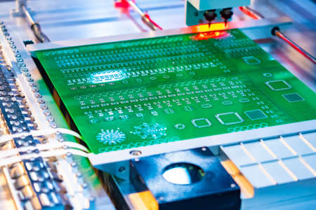 The machine for the production of printed circuit boards. Manufacture of printed circuit Board without human intervention. Programmable machine. Production automation. Electronic components.