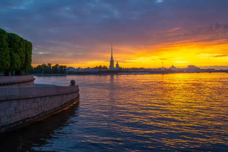 St. Petersburg. Russia. View of the Peter and Paul Fortress from the Spit of Vasilyevsky Island. Petersburg Embankment. Granite balls on Vasilyevsky Island. Sunset on the Neva. Cities of Russia.