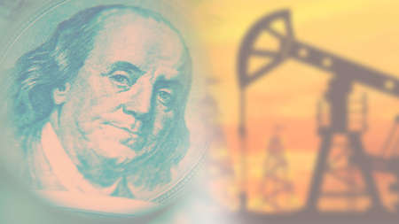Oil production. Price of crude oil. Petrodollars. An oil rig and a dollar on a blurry background. Mining of natural resources. Fuel industry.