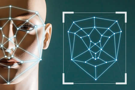 Biometric identification of a person. The use of biometric information. The geometry of the face to determine identity. Dots on the face create a digital portrait of a person. Stock fotó