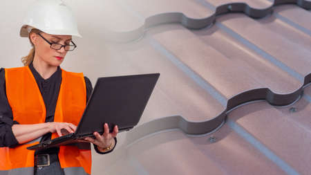 A girl in an orange vest and hard hat holds a laptop. Monitoring the progress of construction of the house. An engineer examines the roof of a cottage under construction. Choice of roofing materials. Imagens