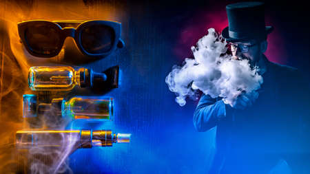 The concept of vaping. A vaper in a black top hat. A man in a top hat lets out smoke against the background of Smoking accessories. Bright collage on the topic of Smoking electronic cigarettes.
