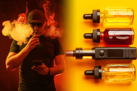 The concept of floating on a yellow background. A man in black glasses smokes an electronic cigarette. Smoker against the background of VIPs and vials of liquids.