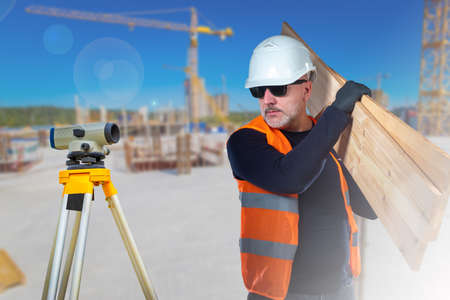 Surveyor and carpenter on the construction site. Types of construction work. Construction of buildings. Vacancies for builders.