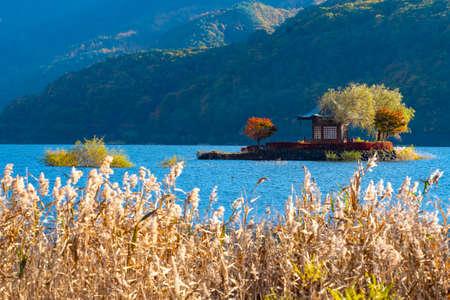 Lake Kawaguchiko. Japan in autumn. Gazebo on the island. Five Lakes Of Fuji. The Village Fujikawaguchiko. Japanese lake landscape. Tourism in Japan. Panorama of lake Kawaguchiko. Travel to East Asia.