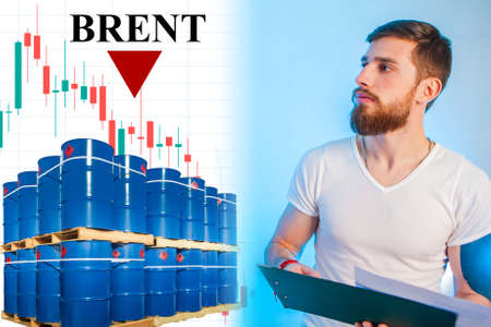 The fall in oil prices. Crisis in the oil market. A man studies the news on the oil market. Brent text and down arrow. The decline in fuel prices.