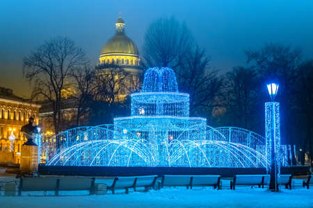 Saint-Petersburg. Russia. Luminous fountain at the Admiralty. Winter fountain. Led figure. St. Petersburg New year decor. Christmas traveling to Petersburg. New year in Russia. Winter Petersburg.