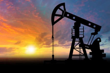 Oil industry. Oil production. Oil rig on the background of the sunset. Natural resource extraction. Fuel industry.
