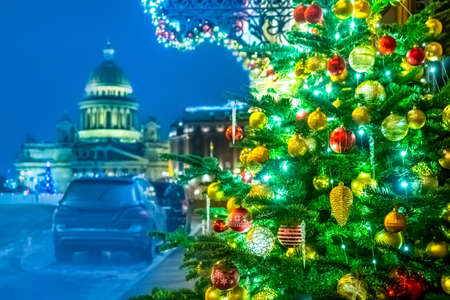 Saint-Petersburg. Russia. Decorated Christmas tree. New year Isaakievsky cathedral. St. Petersburg streets Christmas decorations. Christmas travel to Petersburg. New year in Russia. Winter Petersburg.