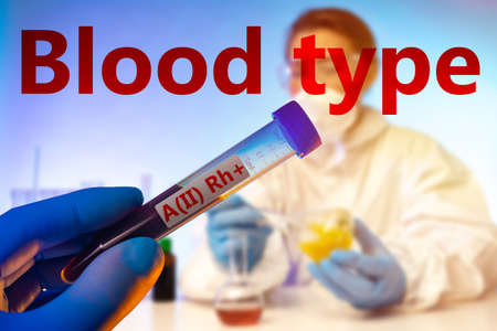 Test tube and red label blood type. Blood group. RH factor. The second group of blood with a positive rhesus. Donorship. Medical test. Care of health.