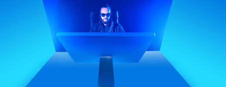 The concept of computer dependency. Geometric background with a man at the computer. Blue computering background. Gamer black glasses and a jacket with a hood.