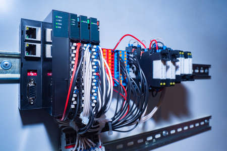 A switchboard with wires. Connecting equipment. Voltage switchboard with circuit breakers. Electrical background. Archivio Fotografico