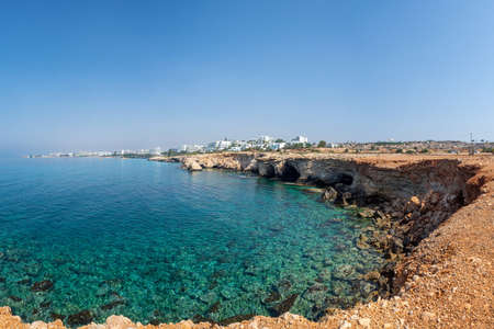 Republic of Cyprus. Panorama of the Mediterranean coast. Rocky coast and emerald water of the Mediterranean sea. Cape Greco. Ayia NAPA. Hotels are located close to the coastline. Stay in Cyprus. Banco de Imagens