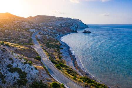 Cyprus from a height. The Mediterranean coast from a drone. Mountain road along the sea coast. Aphrodite's Stone. Pathos. Kuklia. Petra tou Romiou. The Mediterranean coast at sunrise.