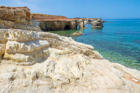 Cyprus. Ayia NAPA. Cape Greco. Sandstone cliffs on the coast of the Mediterranean sea. Natural landscape of the Mediterranean. Nature Of Cyprus. Trip to Cape Greco. Clear emerald water in the sea.