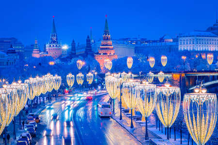 Christmas Moscow. Panorama of new year Moscow. Christmas decorations on the background of the Kremlin. Winter evening in the capital of Russia. Festive decorations of Moscow streets. Snow and garlands