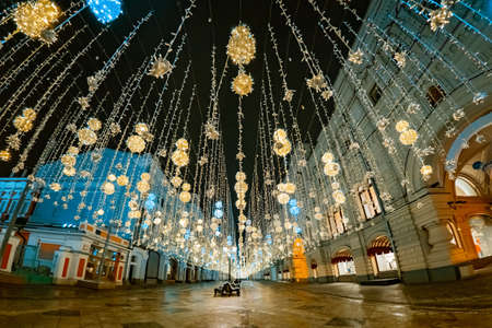 Russia in Christmas. The streets of Moscow in Illumination. Excursion through the streets of the capital at Christmas. Night sidewalk with the Garlands. Russians capital in winter. New year holidays.