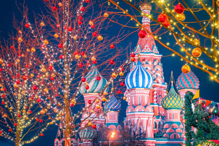 Christmas greetings from Russia. St. Basil Cathedral on the background of Christmas decorations. Christmas decorations on red square. New year in Moscow. Christmas evening in the capital of Russia. Stok Fotoğraf