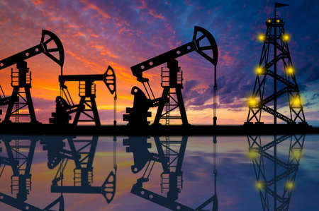 Oil production. The oil platform is reflected in the water. Oil production. Extraction of minerals. Fuel industry. Oilfield equipment.