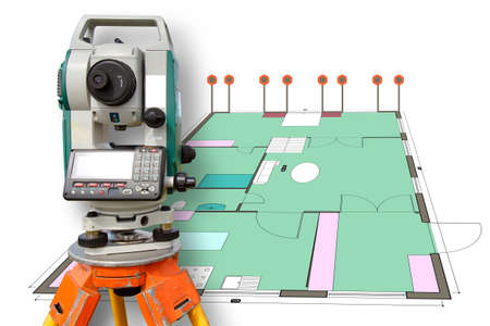 Measuring equipment in construction. Geodesy. Geodesic equipment on the background of the house layout. Theodolite or total positioning station.