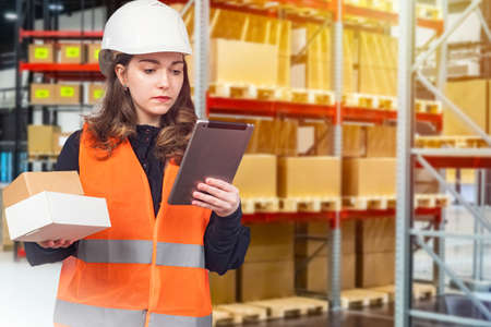 Storekeeper in a supermarket. The girl works in the warehouse of a large store. Delivery of goods from the warehouse to the sales floor. Storage and accounting of products in the store.