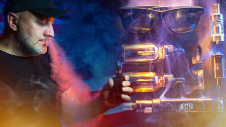 VAPE Smoking. The pleasure of Smoking an electronic cigarette. VAPE shop. A man in a black baseball cap smokes an e-cigarette and smiles. Accessories for electronic cigarettes.