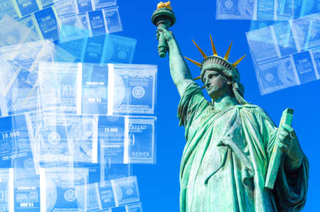 The statue of Liberty on the background of bundles of dollars. American currency. Currency of the United States. American market.