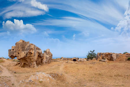 Ruins of the ancient city of Paphos. Remains of ancient buildings under a blue sky with clouds in Cyprus. Archaeological excavations on the coast of the Mediterranean sea. Archeology.