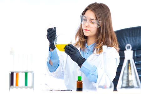 A woman in a chemical laboratory. The chemist conducts experiments. A scientist, researcher, technician, or student in a laboratory. Research in the field of medicine. Pharmacological developments.