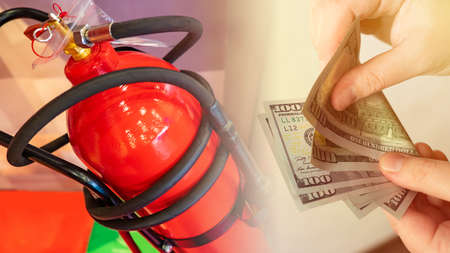 Hands with money and a new fire extinguisher. Provision of fire safety requirements in buildings. Purchase of fire extinguishing equipment. Extinguishers at the enterprise.