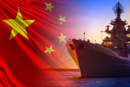 A warship is anchored against the background of the flag of China. PRC's fleet. Naval forces of China. Navy of the Republic of China. Protection of water borders of the country.