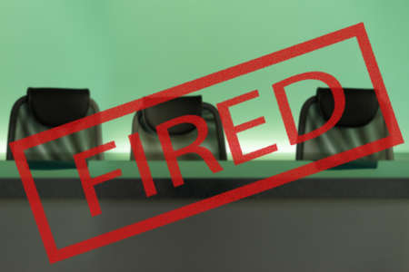 Fired. Concept - the labor market collapsed. fired on the background of empty armchairs. Concept - recession led to mass layoffs. bankruptcy led to the dismissal of employees. Unemployment. 版權商用圖片