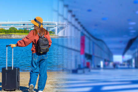 Girl looks at the flyover. Covered flyover inside. Woman with a travel suitcase. Concept - girl cannot get to other side. Girl tourist stands with his back to the camera. Traveler admires the strait
