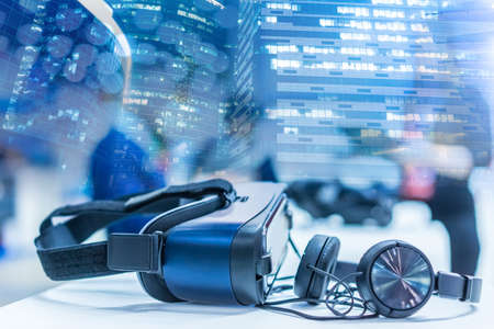 Equipment for immersion in virtual reality. Glasses. Headphones. Concept - selling glasses for virtual reality. Glasses for placing a smartphone. Walls skyscrapers. Concept - traveling with gadgets