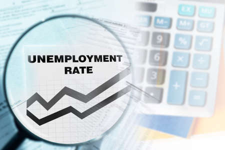 Unemployment rate. Report labor market under a magnifying glass. Inscription unemployment rate next to schedule. Increase dismissal in world. Counting unemployment. Growth of layoffs due bankruptcies