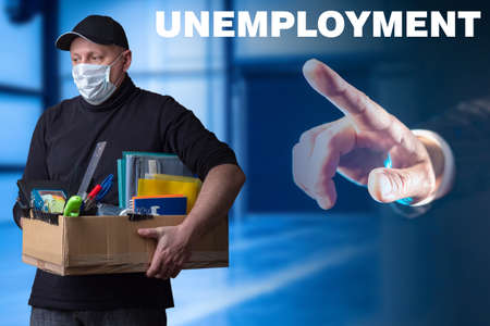 Unemployment. Quarantine dismissal. Man holds box for layoffs. Dismissed man in medical mask. Concept - is shown finger at exit. Man was fired. Unemployment associated with coronavirus. Covid-19.