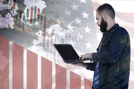 Man with a laptop on background of US flag. Investor works with American securities. Concept - investing in US government bonds. Declining chart demonstrates falling prices for US government bonds