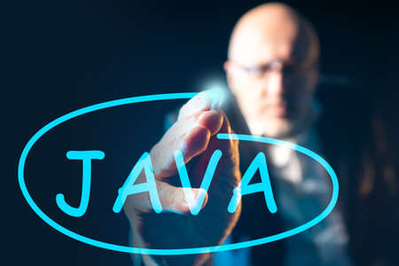 Javascript programming. Man drew java on the screen. Concept - development of application in the java language. Software development. Javascript developer. Recruiter is looking for java programmers