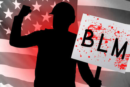 Black Lives Matter. Man holds a poster with the inscription BLM. Black protests in USA. Protester on background of flag of America. Protestor's transparency is stained with blood. Against police USA 免版税图像