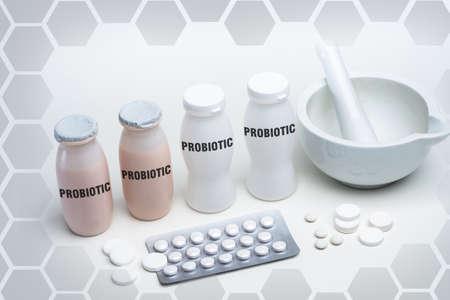 Probiotics. Plate for grinding preparations. Concept - shredded probiotics are added to bottle. Table for making probiotics. Microbiologist's desktop. Making preparations for intestines.